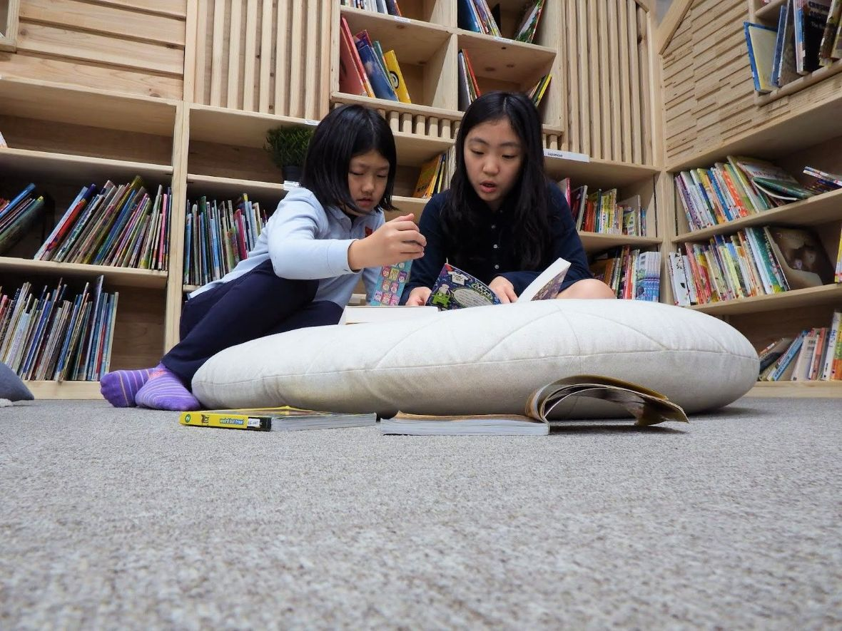 Students are reading books in Shinagawa International School Library and Library center from school facilities