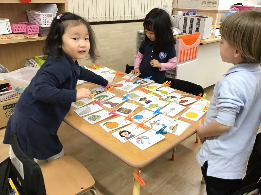 School Day Care with Pre-K students who play card games at SIS