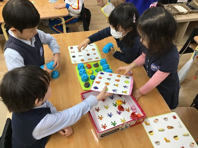 Day care with Pre-K students who play games at SIS