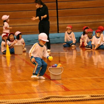 Pre-K students who doing ball relay