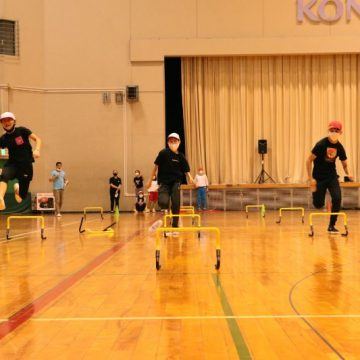Middle school students are doing running race with jumping hurdles in Sports Day 2020