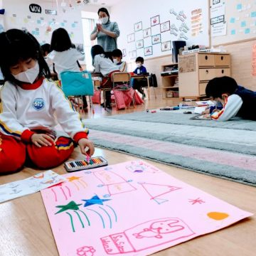 Grade 1 student is drawing pictures during Arts Week at School