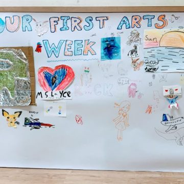Arts Week Poster on the wall of hallway