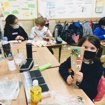 Grade 3 students create hand made games in classroom