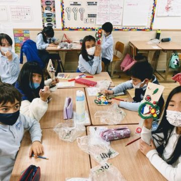 Grade 2 students create hand made games in classroom