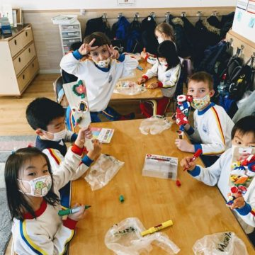 Grade 1 students create hand made games in classroom