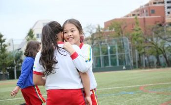 SIS Students are in soccer field of School facilities