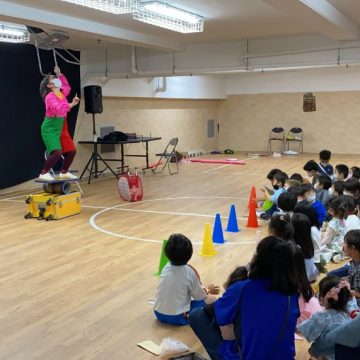 Clown Rio and Acrobat Marinka Show in front of early year students