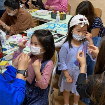 Some of students are doing art craft with teachers in International Children's Day 2021