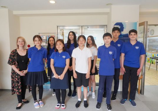 Grade 8 students from middle school with teacher
