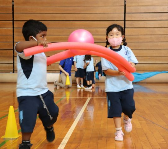 Ball relay activity with early years students
