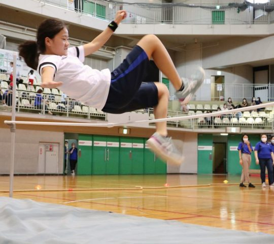 Grade 8 student is doing long jump in Sports day 2021